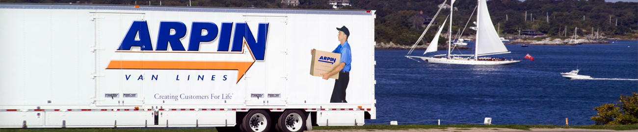 Arpin truck in front of body of water