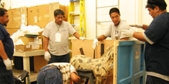 Crew packing an item for storage