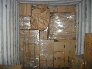 Stack of specially packaged items for shipping