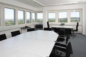 empty conference room, white table with windows